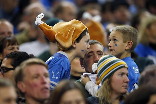 Detroit Lions fans are seen in attendance during the third quarter of an NFL football game between the Lions and the Green Bay Packers at Ford Field in Detroit, Thursday, Nov. 28, 2013. (AP Photo/Rick Osentoski)
