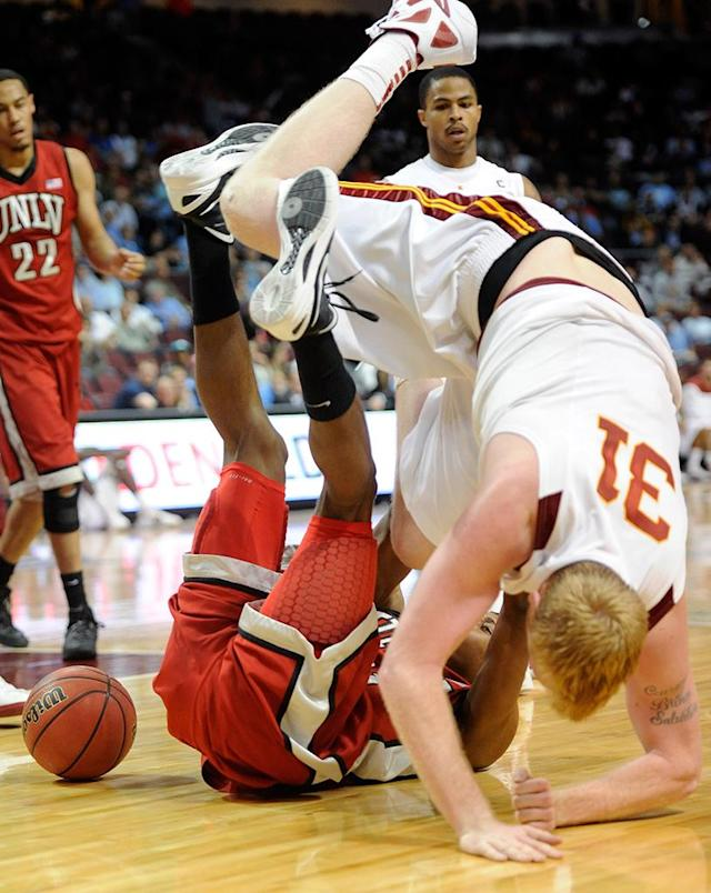 Justin Hawkins (L) #31 of the UNLV Rebels and James Blasczyk #31 of the USC Trojans tumble over each other while going for a loose ball during the third round of the Continental Tire Las Vegas Invitational at the Orleans Arena November 25, 2011 in Las Vegas, Nevada. (Photo by Ethan Miller/Getty Images)