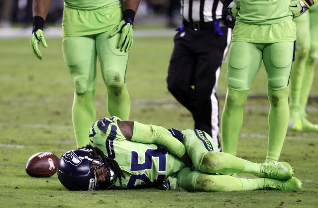 "<a class=""link rapid-noclick-resp"" href=""/nfl/players/24941/"" data-ylk=""slk:Richard Sherman"">Richard Sherman</a> lies injured on the turf during the second half of a ""Thursday Night Football"" game in November. Sherman suffered a season-ending leg injury. (AP)"
