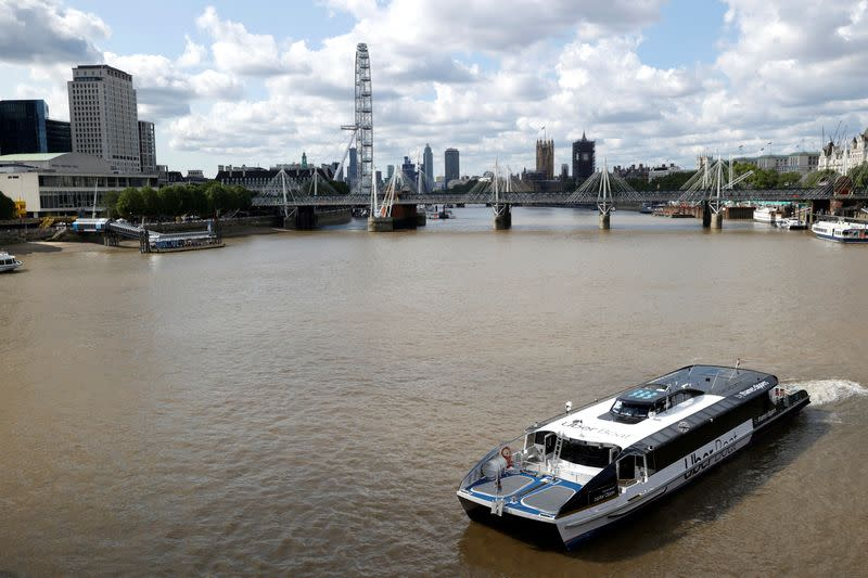 An Uber boat operates following the launch of the new boat service on the River Thames in London