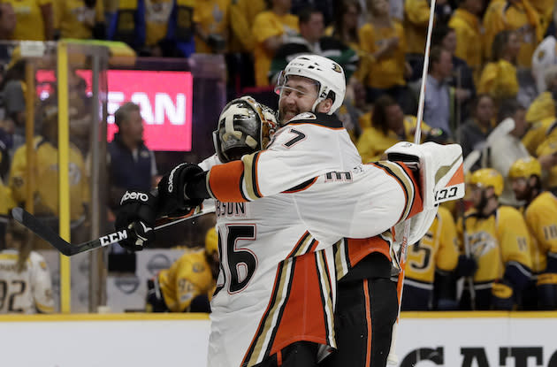 "<a class=""link rapid-noclick-resp"" href=""/nhl/teams/ana/"" data-ylk=""slk:Anaheim Ducks"">Anaheim Ducks</a> center <a class=""link rapid-noclick-resp"" href=""/nhl/players/3802/"" data-ylk=""slk:Andrew Cogliano"">Andrew Cogliano</a> (7) celebrates with goalie <a class=""link rapid-noclick-resp"" href=""/nhl/players/5407/"" data-ylk=""slk:John Gibson"">John Gibson</a> (36) after defeating the <a class=""link rapid-noclick-resp"" href=""/nhl/teams/nas/"" data-ylk=""slk:Nashville Predators"">Nashville Predators</a> in overtime of Game 4 of the Western Conference final in the NHL hockey Stanley Cup playoffs Thursday, May 18, 2017, in Nashville, Tenn. The Ducks won 3-2. (AP Photo/Mark Humphrey)"