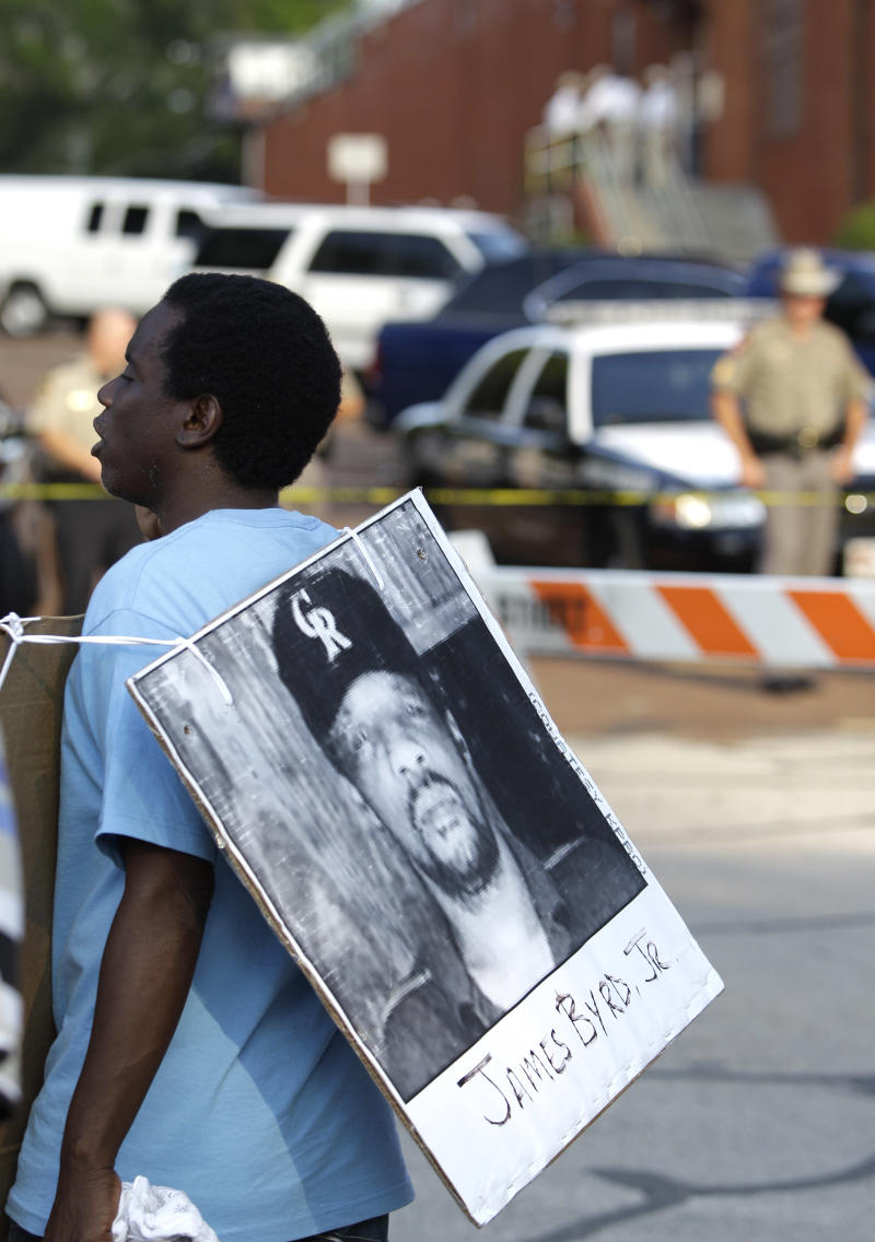 Ricky Jason wears a photograph of James Byrd Jr. outside the Texas Department of Criminal Justice Huntsville Unit before the execution of Lawrence Russell Brewer Wednesday, Sept. 21, 2011, in Huntsville, Texas. Brewer, 44, one of two purported white supremacists condemned for the dragging death of James Byrd Jr., was executed Wednesday. Brewer was convicted for his participation in chaining Byrd to the back of a pickup truck, dragging the black man along a rural East Texas road and dumping what was left of his shredded body outside a black church cemetery in 1998. (AP Photo/David J. Phillip)
