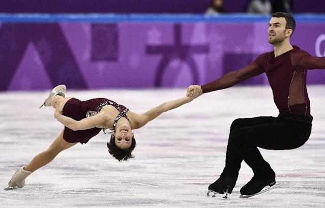 Eric Radford and Meagan Duhamel helped Canada to team figure skating gold. (AFP Photo/ARIS MESSINIS)