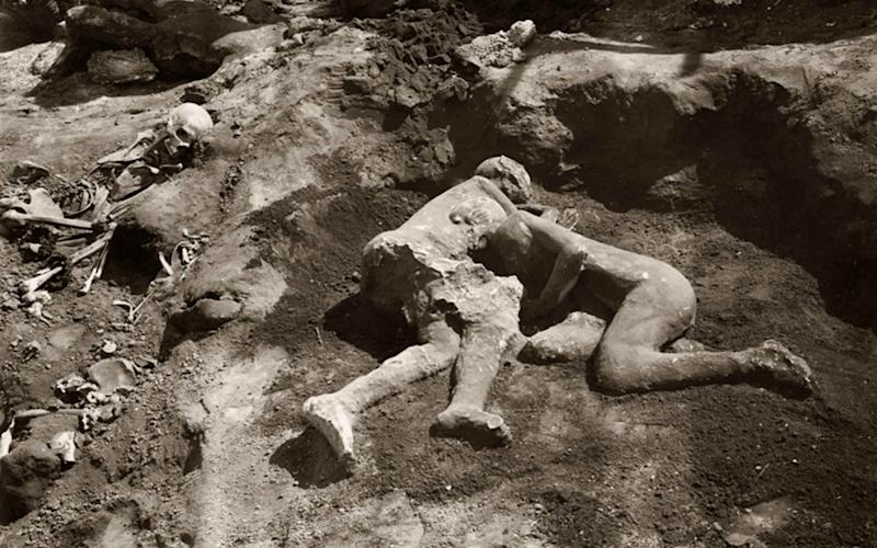 The two bodies were found wrapped in a poignant embrace in their final moments as they were covered beneath molten rock and layers of ash in the ancient city of Pompeii - Splash News
