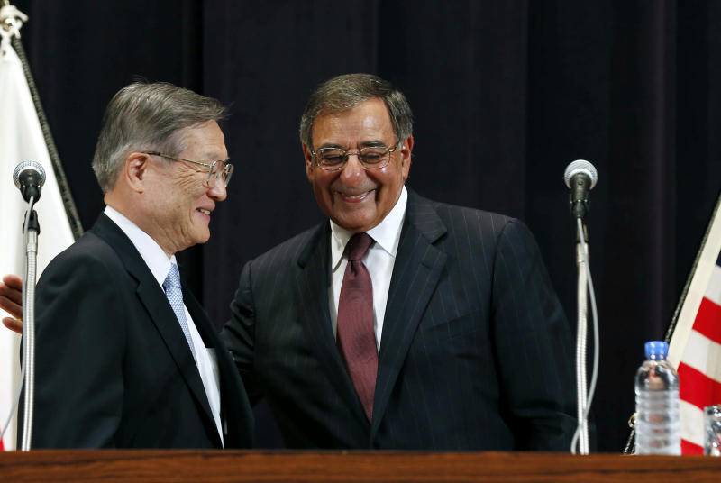 U.S. Secretary of Defense Leon Panetta, right, and Japan's Defense Minister Satoshi Morimoto smile at the end of a joint news conference at the Ministry of Defense in Tokyo, Monday, Sept. 17, 2012. (AP Photo/Larry Downing, Pool)