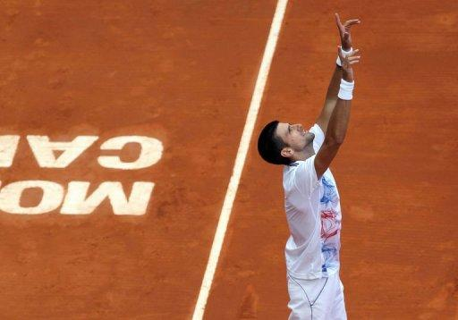 Serbia's Novak Djokovic reacts at the end of his Monte-Carlo ATP Masters Series Tournament tennis match he won after having learnt the death of his grandfather earlier in the day, in Monaco. Djokovic won against Ukraine's Alexandr Dolgopolov, 2-6, 6-1, 6-4