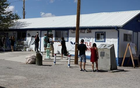 <span>Attendees arrive at the Little A'Le'Inn as an influx of tourists responding to a call to 'storm' Area 51</span> <span>Credit: Reuters </span>