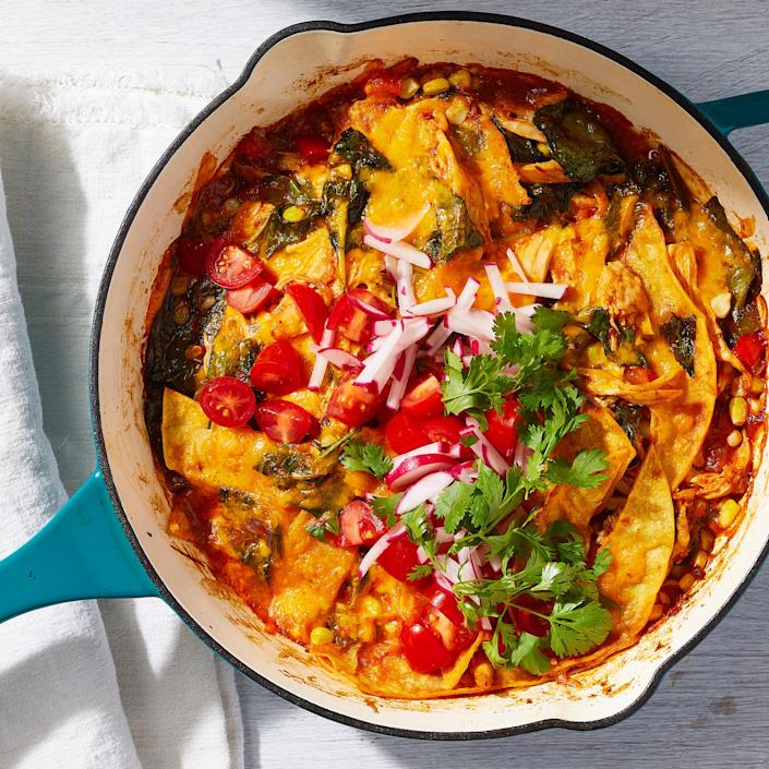 """<p>This take on cheesy chicken enchiladas skips the need to stuff and roll corn tortillas. Instead, we scatter tortilla strips throughout the filling and bake it, so you'll still get the same flavors and textures, but in record time. This recipe was adapted from our popular <a href=""""https://www.eatingwell.com/recipe/7885252/chicken-enchilada-skillet-casserole/"""" rel=""""nofollow noopener"""" target=""""_blank"""" data-ylk=""""slk:Chicken Enchilada Skillet Casserole"""" class=""""link rapid-noclick-resp"""">Chicken Enchilada Skillet Casserole</a> to serve two instead of six. <a href=""""https://www.eatingwell.com/recipe/7918727/chicken-enchilada-skillet-casserole-for-two/"""" rel=""""nofollow noopener"""" target=""""_blank"""" data-ylk=""""slk:View Recipe"""" class=""""link rapid-noclick-resp"""">View Recipe</a></p>"""