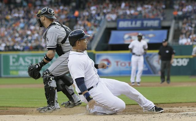 Detroit Tigers' Miguel Cabrera beats the throw to Chicago White Sox catcher Tyler Flowers during the first inning of a baseball game, Wednesday, July 30, 2014 in Detroit. (AP Photo/Carlos Osorio)