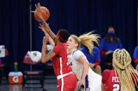 DePaul guard Dee Bekelja, center, drives to the basket against St. John's guard Kadaja Bailey during the second half of an NCAA college basketball game in Chicago, Wednesday, Jan. 13, 2021. (AP Photo/Nam Y. Huh)