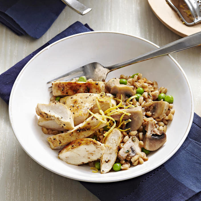 <p>Farro is chewier than Italian rice and adds an earthy flavor to the lemon-pepper chicken and spring peas in this tasty risotto recipe.</p>