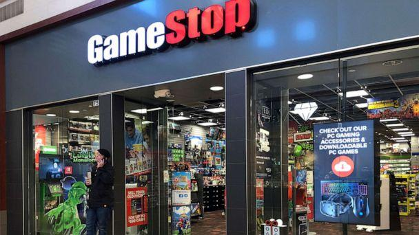 PHOTO: A man talks on a cell phone outside a GameStop store in Gurnee, Ill., Dec. 10, 2019. (Tannen Maury/EPA via Shutterstock)