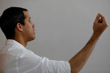 Venezuelan opposition leader Juan Guaido, who many nations have recognized as the country's rightful interim ruler, gestures during an interview with Reuters in Caracas, Venezuela March 22, 2019. REUTERS/Carlos Jasso