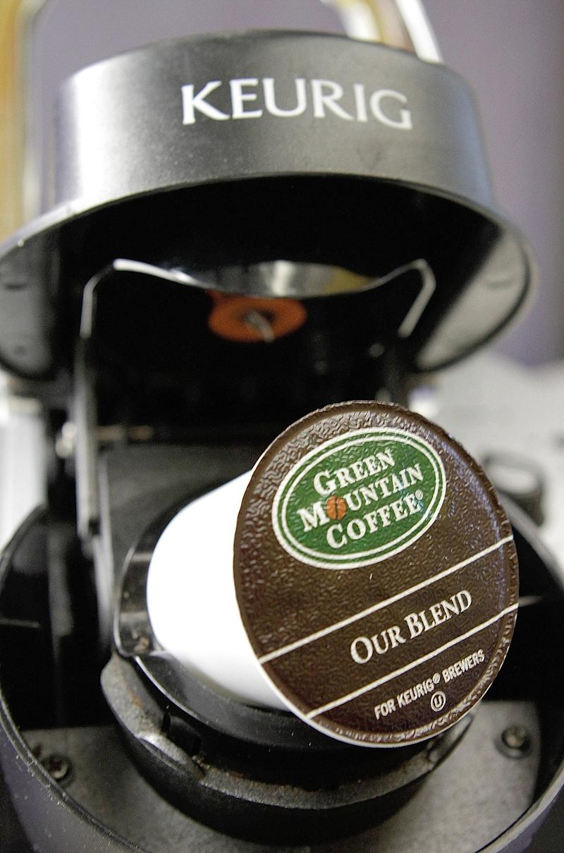 FILE-In this Oct. 7, 2010, file photo, a Green Mountain Coffee single-serving brewing cup is seen in a Keurig machine in Montpelier, Vt.  Starbucks Corp. and Green Mountain Coffee Roasters Inc. say they have reached a deal that will bring single-cup Starbucks coffee and Tazo tea pods to Keurig users. Starbucks has been looking to beef up its presence in the fast-growing single-cup coffee market and Green Mountain is considered one of its leaders.(AP Photo/Toby Talbot, file)