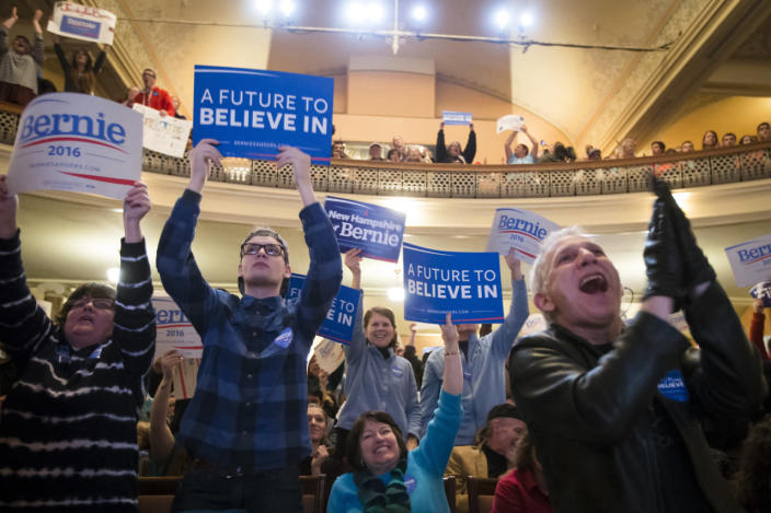<p>New Hampshire supporters cheer Bernie Sanders at the Claremont Opera House, Tuesday, Feb. 2, 2016, in Claremont, N.H. <i>(Photo: John Minchillo/AP)</i></p>