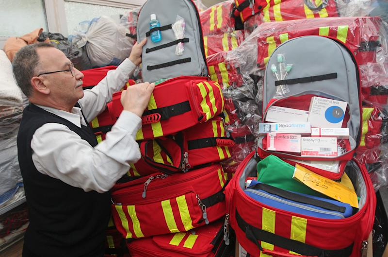 In this photo taken Friday, April 26, 2013, Belgian-Syrian Pharmacist Abu Yamen shows some first aid kits and medicines he prepared to ship to Syria, in Brussels. Yamen is in the midst of preparing a shipment of medical supplies for the Syrian opposition which would be sent overland from Brussels to Turkey. (AP Photo/Yves Logghe)