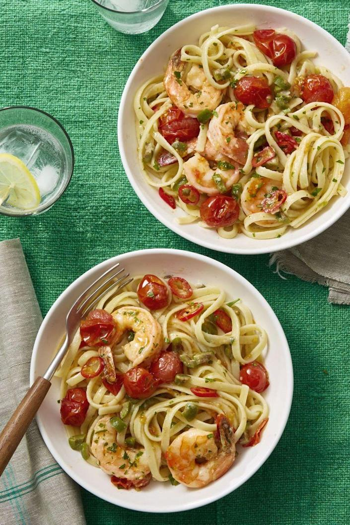 """<p>Add some Mediterranean flare to your weekly meal rotation with this robustly flavored dish.</p><p><em><a href=""""https://www.womansday.com/food-recipes/food-drinks/recipes/a60706/shrimp-puttanesca-recipe/"""" rel=""""nofollow noopener"""" target=""""_blank"""" data-ylk=""""slk:Get the Shrimp Puttanesca recipe."""" class=""""link rapid-noclick-resp"""">Get the Shrimp Puttanesca recipe.</a></em></p>"""