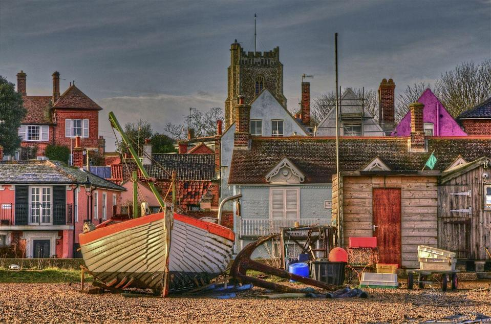 """<p>The Suffolk seaside town has plenty to offer those needing some rest and relaxation away from London. While most people will tell you to visit The Red House (the former home of composer Benjamin Britten) in Aldeburgh, we advise treading a less frequented path. </p><p>Pay a visit to the Aldeburgh Cinema, an old-fashioned picture house that's been screening films since 1919, the four-metre high steel scallop on the beach and the boating lake, Thorpeness Meare.</p><p> The best fish and chips will be found at Aldeburgh fish and chips (we suggest the haddock) and ice cream at Harris & James Store. What are you waiting for?</p><p><strong>Distance from London</strong>: 109.3 miles</p><p><strong>How to get there</strong>: London Liverpool Street to Saxmundham to Alderburgh via <a href=""""https://www.thetrainline.com/book/results?origin=a994b357084b0548e2b14a0c76ca0ac0&destination=754d400bc1a3566213e1e33b504d59b3&outwardDate=2020-07-16T14%3A00%3A00&outwardDateType=departAfter&journeySearchType=single&passengers%5B%5D=1990-07-16&selectedOutward=ZCRAtsI6VDA%3D%3A7od1XBjoDrY%3D"""" rel=""""nofollow noopener"""" target=""""_blank"""" data-ylk=""""slk:train"""" class=""""link rapid-noclick-resp"""">train</a> (2hr 45mins).</p>"""