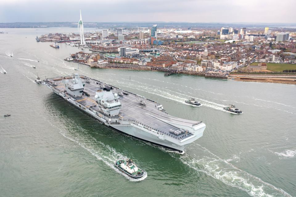 HMS Queen Elizabeth sets sail from Portsmouth on Saturday afternoon. (SWNS)