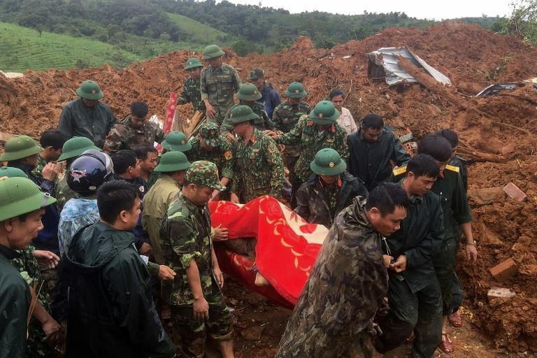 Rocks rained down on the barracks of a military station in Quang Tri province, with 22 soldiers believed to have been buried underneath thick mud