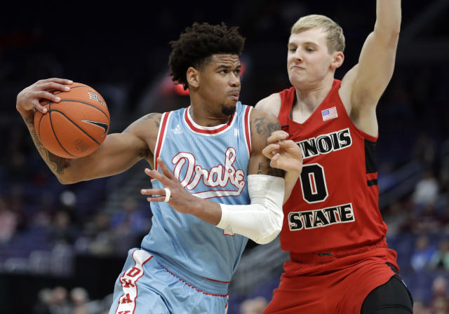 Drake's Tremell Murphy, left, heads to the basket past Illinois State's Isaac Gassman during the first half of an NCAA college basketball game in the quarterfinal round of the Missouri Valley Conference tournament, Friday, March 8, 2019, in St. Louis. (AP Photo/Jeff Roberson)