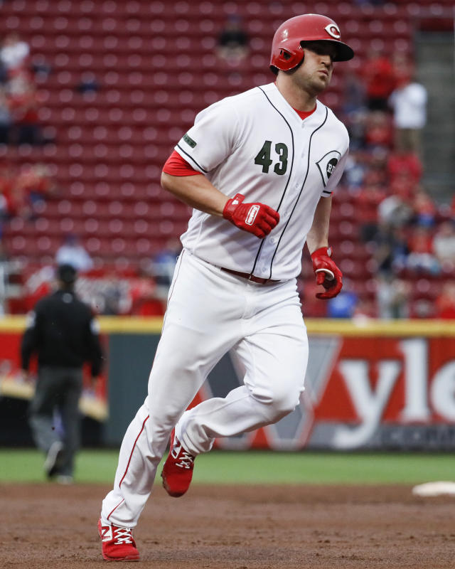 Cincinnati Reds' Scott Schebler runs the bases after hitting a solo home run off Los Angeles Dodgers starting pitcher Hyun-Jin Ryu in the third inning of a baseball game, Tuesday, Sept. 11, 2018, in Cincinnati. (AP Photo/John Minchillo)