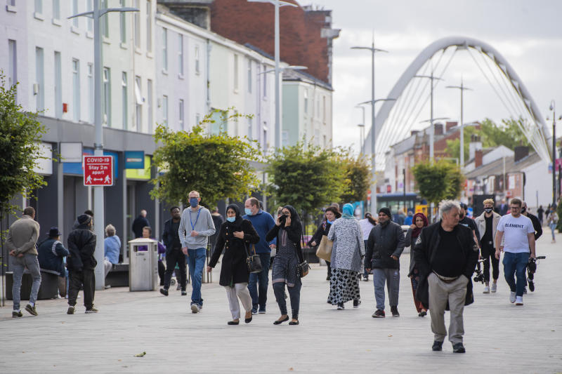 BOLTON, ENGLAND - SEPTEMBER 09: Members of the public wear face masks in Bolton town centre as Coronavirus restrictions are tightened in the area on September 09, 2020 in Bolton, England. (Photo by Anthony Devlin/Getty Images)