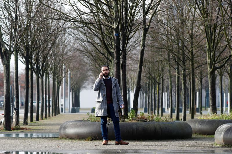 Syrian migrant Tareq Alaows poses during an interview with Reuters in Berlin