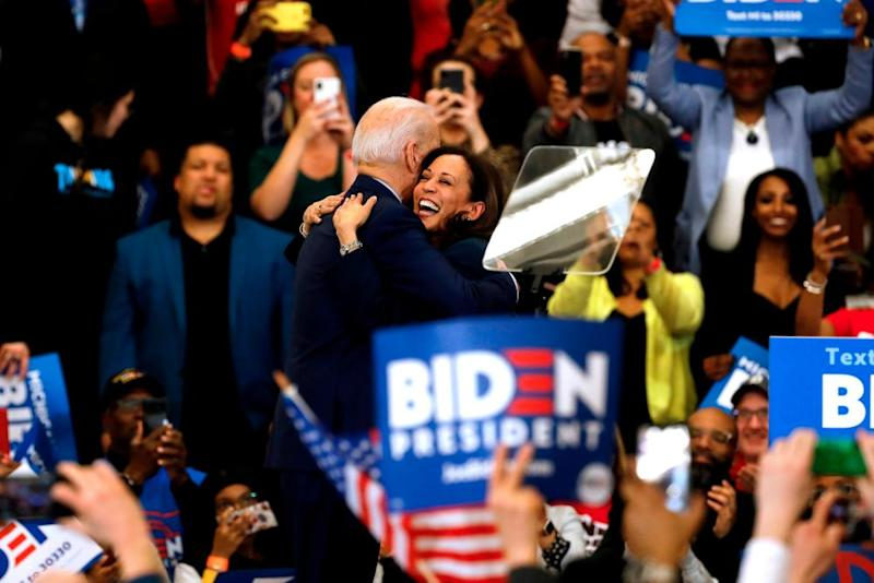 Harris hugs Biden after she endorsed him at a campaign rally in Detroit in March.