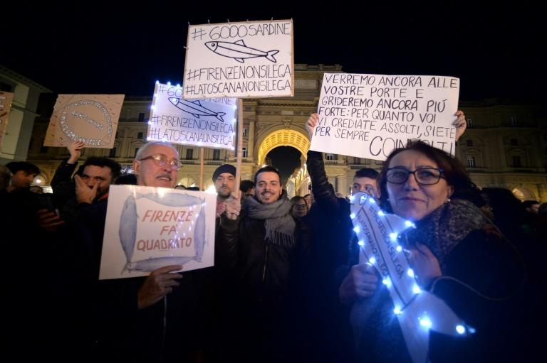 "Demonstrators gathered in the city's Piazza della Repubblica sang the anti-fascist song ""Bella Ciao"" (AFP Photo/Filippo MONTEFORTE)"