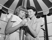 <p>Two women split a milkshake to cool down from the Southern California sun in Hollywood.</p>