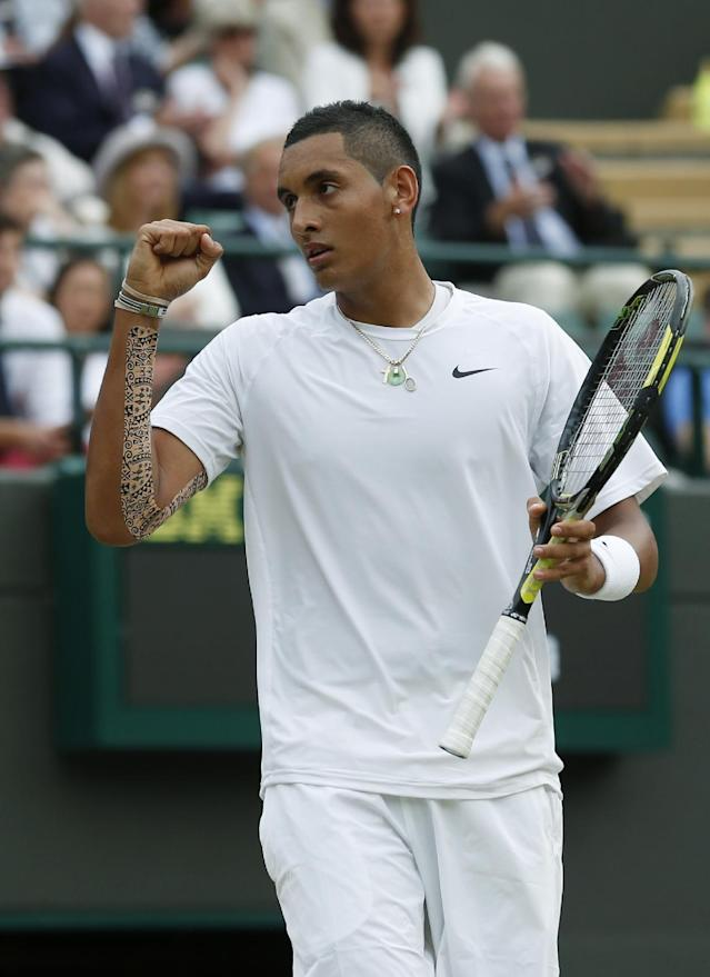 Nick Kyrgios of Australia celebrates a point against Milos Raonic of Canada during their men's singles quarterfinal match at the All England Lawn Tennis Championships in Wimbledon, London, Wednesday, July 2, 2014. (AP Photo/Ben Curtis)