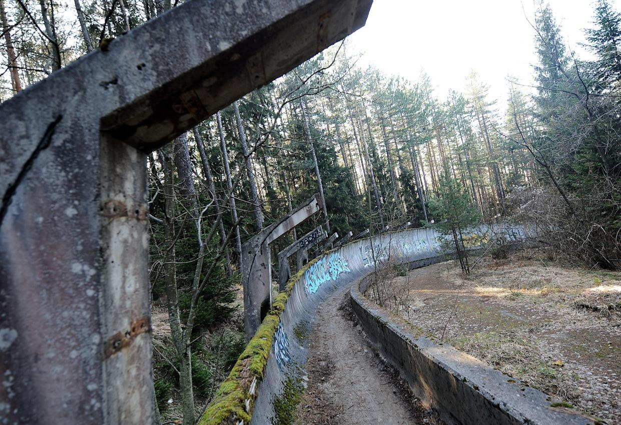 TO GO WITH STORY BY RUSMIR SMAJILHODZIC - A picture taken on February 5, 2014 shows Sarajevo's abandoned  Sarajevo's bob sleigh track near Sarajevo. Built and used as an Olympic venue during Sarajevo's 1984 Winter Olympic Games, the track was heavily damaged during Bosnia's 1992-95 war. It was never rebuilt and it's large concrete fragments remain standing as a memento of past and training ground for young generations of graffiti artists.  AFP PHOTO ELVIS BARUKCIC / AFP / ELVIS BARUKCIC        (Photo credit should read ELVIS BARUKCIC/AFP via Getty Images)
