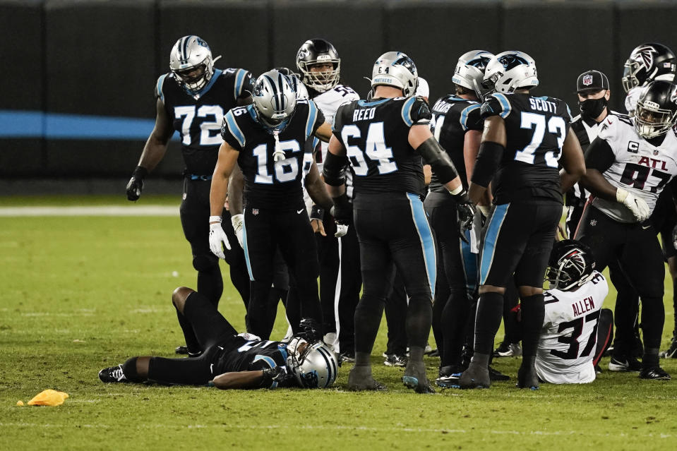 Carolina Panthers quarterback Teddy Bridgewater is injured on the field during the second of an NFL football game against the Atlanta Falcons Thursday, Oct. 29, 2020, in Charlotte, N.C. (AP Photo/Gerry Broome)