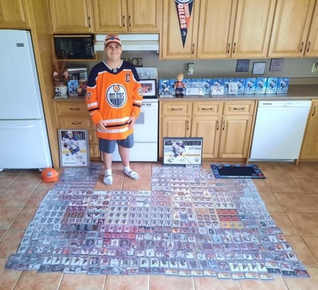 Recchi Robichaud has expanded his collection of Connor McDavid hockey cards to nearly 500, and was featured on the Edmonton Oilers social media pages twice..  (Submitted/Paula Robichaud - image credit)