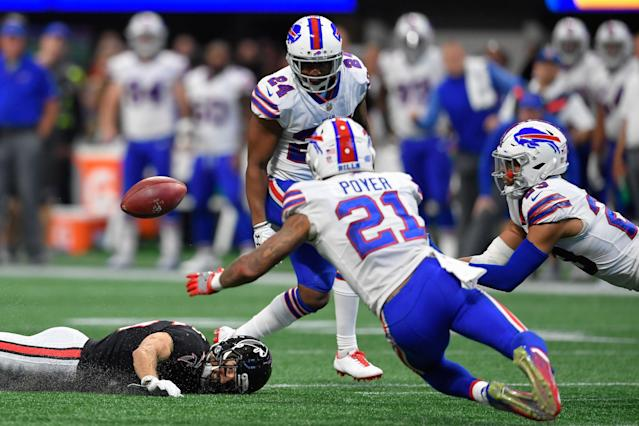 <p>Buffalo Bills strong safety Micah Hyde (23) (far right) makes a diving pass interception after the ball deflected off of Atlanta Falcons wide receiver Nick Williams (15) during the fourth quarter at Mercedes-Benz Stadium. Mandatory Credit: Dale Zanine-USA TODAY Sports </p>