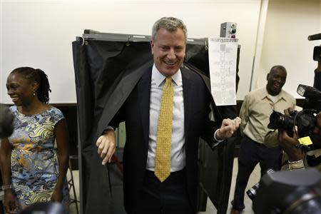 New York City democratic mayoral candidate Bill de Blasio exits a voting booth in the Brooklyn borough of New York