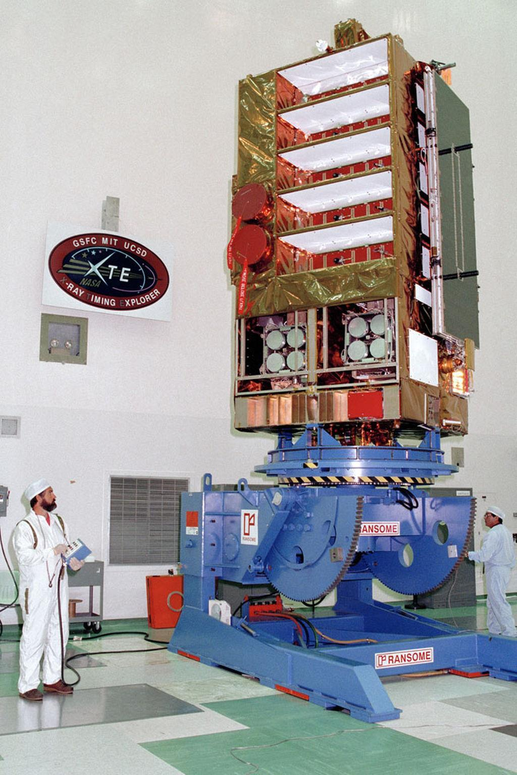 NASA's Rossi X-ray Timing Explorer satellite, shown here during prelaunch checks in 1995, was built to study the time variation of X-ray sources in space. <cite>NASA</cite>