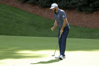 Dustin Johnson reacts after a birdie on the 13th hole during the final round of the Masters golf tournament Sunday, Nov. 15, 2020, in Augusta, Ga. (Curtis Compton/Atlanta Journal-Constitution via AP)