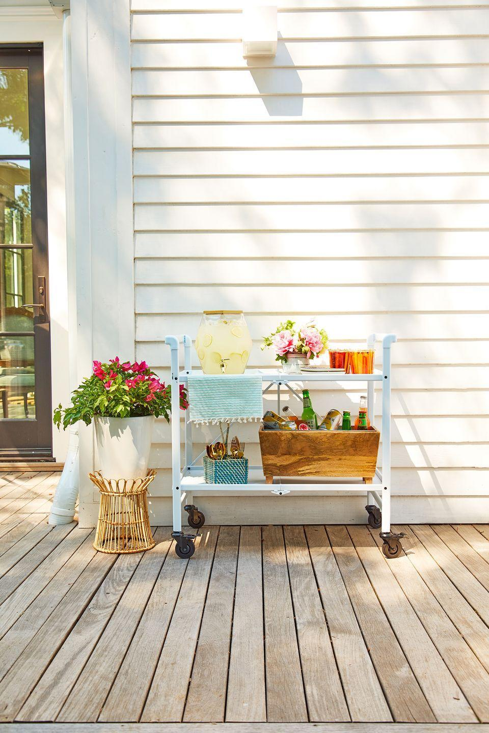 <p>Use your bar cart to enhance your outdoor oasis and bring charm to your summer gatherings. Just display a selection of your favorite summer beverages, brighten it up with fresh flowers, and you're all set. </p>