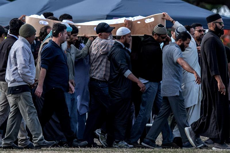A coffin containing the body of a victim of the Christchurch terrorist attack is carried for burial at Memorial Park Cemetery. (Getty Images)