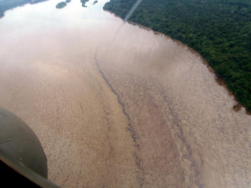 This photo released by Petroecuador Tuesday, June 4, 2013 shows an aerial view of an oil spill in Ecuador's Coca River caused when a landslide damaged a main pipeline of Ecuador's state oil company, near the volcano El Reventador, in Ecuador's Amazonian region, Friday, June 1, 2013. The Friday landslide damaged the trans-Ecuador pipeline, causing the spill of some 420,000 gallons (1.6 million liters) of crude oil. Some entered the Coca river, a tributary of the Amazon that also flows through Peru and Brazil. (AP Photo/ Petroecuador)
