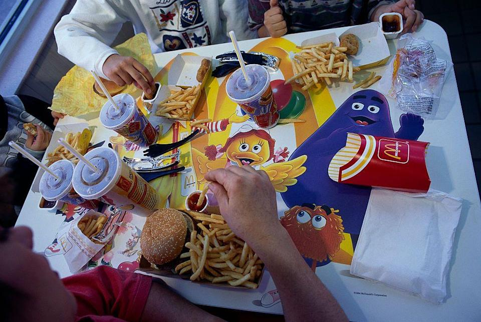 <p>McDonald's advertisements have featured a crew of cartoons since the '80s, including Birdie, Hamburglar, Grimace, and the Professor. They even appear around the restaurants, as seen on a table here.</p>