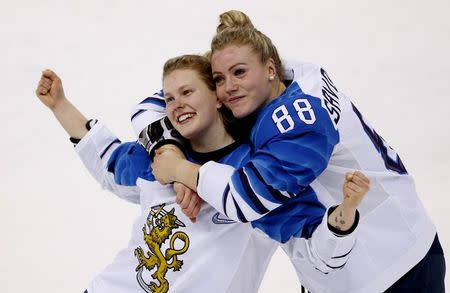 Ice Hockey - Pyeongchang 2018 Winter Olympics - Women's Bronze Medal Match - Finland v Olympic Athletes from Russia - Kwandong Hockey Centre, Gangneung, South Korea - February 21, 2018 - Noora Tulus and Ronja Savolainen of Finland celebrate after the match. REUTERS/Kim Kyung-Hoon