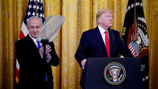 PHOTO: Israel's Prime Minister Benjamin Netanyahu and President Donald Trump take part in an announcement of Trump's Middle East peace plan in the East Room of the White House in Washington, D.C. on Jan. 28, 2020. (Mandel Ngan/AFP via Getty Images)