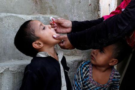 Boy receives polio vaccine drops during an anti-polio campaign in Karachi