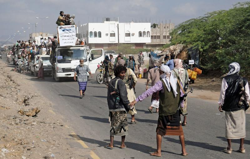 FILE - In this Saturday, Jan. 14, 2012 file photo, Yemeni residents, who fled nearly eight months of fighting between the army and Islamists, return home in Zinjibar, Yemen. Yemeni government troops fought their way into the center of an al-Qaida-held city in the lawless south after a fierce, six-hour battle that ended early Tuesday April 24, 2012, military officials said. (AP Photo/Abdullah al-Sharafy, File)