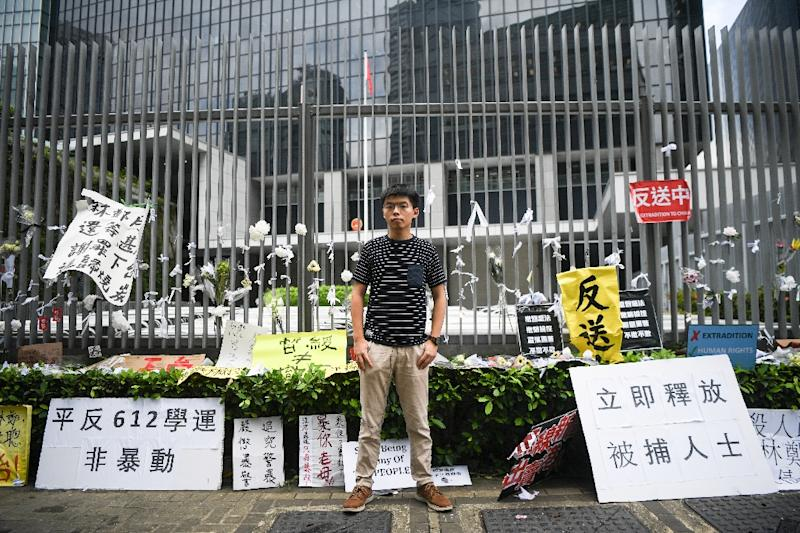 Hong Kong democracy activist Joshua Wong poses during an interview with AFP outside the government headquarters (AFP Photo/Anthony WALLACE)