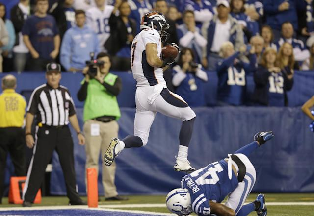 Denver Broncos wide receiver Eric Decker (87) makes a touchdown catch against Indianapolis Colts' Antoine Bethea (41) during the first half of an NFL football game, Sunday, Oct. 20, 2013, in Indianapolis. (AP Photo/Michael Conroy)