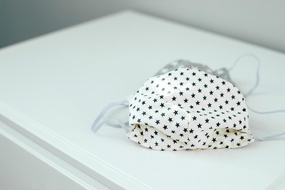 Handmade reusable cotton mask. Face mask protection against pollution, virus, flu and coronavirus. Getty Images.